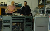 "Mark and Dan Schwartz standing behind a vintage EMI Redd 37 mixing console and Studer J37 4-track recorder. The same make and model that the Beatles used to record the album ""Revolver"""